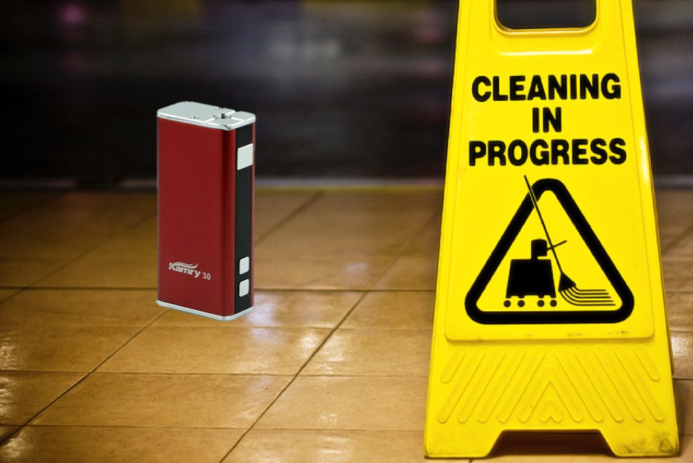 Box mod vape next to a cleaning sign